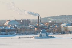 Smoking chimneys of the combined heat and power plant stock images