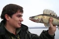 Poissons et pêcheur Photos stock