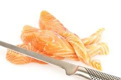 Poissons frais avec le couteau Images stock