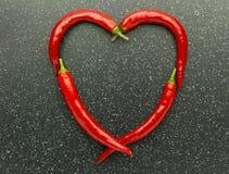 Poivre de piment rouge de coeur Image stock