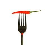 poivron rouge avec des baisses sur une fourchette d'isolement sur un fond blanc Images stock