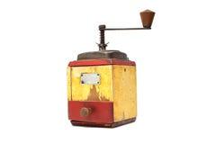 Poivron rouge avec le vieux moulin de poivre sur le blanc photographie stock libre de droits