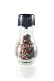 Poivrons chauds dans une bouteille en verre Photos stock