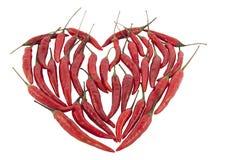 Poivrons de piment rouge à un coeur Photo stock
