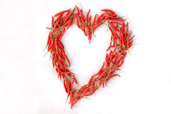 Poivrons de piment rouge dans la forme de coeur Photos libres de droits