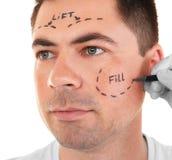 pojęcia odosobniony chirurgii plastycznej biel Ręka w rękawiczkowej ocechowanie twarzy Obrazy Stock