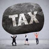Pojęcie biznesu ciężaru drużynowi dostaje podatki Obraz Stock