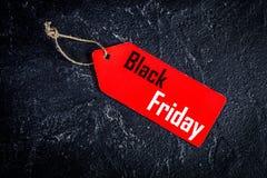 Pojęcie czarny Piątek na ciemnego tła odgórnym widoku Fotografia Stock