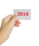 Pojęcie fotografia ręka chwyta 2016 karta Obrazy Stock