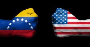 Pojęcie powiązania/konflikt między Venezueal i Stany Zjednoczone Ameryka symbolizował dwa przeciwstawiać zaciskać pięściami obrazy royalty free