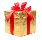 Pojęcie prezent - złocisty pudełko z czerwonym łękiem Zdjęcia Stock