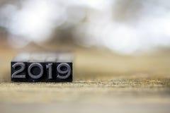 2019 pojęcie rocznika metalu Letterpress słowo Obrazy Stock