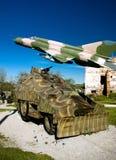 Pojazd wojskowy i MIG 21 samolot Obrazy Royalty Free