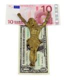 Pojęcie złocisty Jesus crucify odizolowywającego euro dolara Obrazy Stock