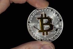 Pojedyncza BTC Bitcoin moneta w ręce Obrazy Royalty Free