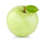 Pojedynczy soczysty zielony jabłko z liśćmi Fotografia Royalty Free
