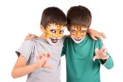 Pojkar med framsida-målarfärg Royaltyfri Bild