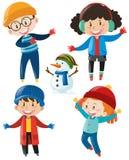 Pojkar och flickor i vinterkläder Arkivfoto