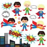 Pojkar och flickor som superheroes Arkivfoto