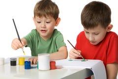 pojkar tecknar två royaltyfria bilder