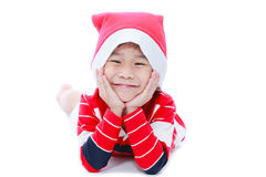 Pojke för lycklig jul som lägger och ler Arkivfoto