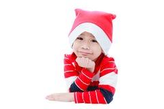 Pojke för lycklig jul som lägger och ler Fotografering för Bildbyråer