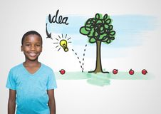 pojke framme av färgrika idédiagram arkivbild