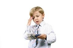 pojke hans tänka för pengar Royaltyfri Foto