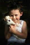 pojke hans valp Arkivfoto