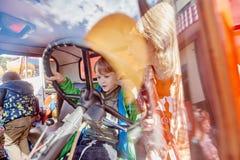 Pojke i brandlastbil Fotografering för Bildbyråer