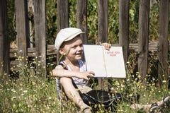 Pojke i byn Royaltyfria Bilder