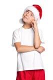 Pojke i den Santa hatten Royaltyfria Bilder