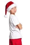 Pojke i den Santa hatten Fotografering för Bildbyråer