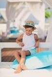 Pojke i en hatt Arkivfoto