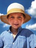 Pojke i en sugrörhatt Fotografering för Bildbyråer