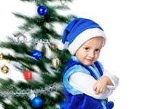 Pojke i ett lock av Santa Claus Royaltyfri Foto