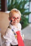 Pojke i exponeringsglas Arkivfoto
