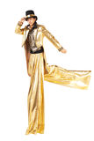 Pojke i guld- spring på styltor Royaltyfria Foton