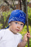 Pojke i gunga Royaltyfria Bilder