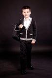 Pojke i official dresscode med ryggsäck Arkivfoto