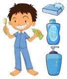 Pojke i pyjamas som borstar tänder stock illustrationer