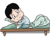 Pojke i säng Royaltyfria Bilder