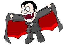 Pojke i vampyrdräkt Arkivbild