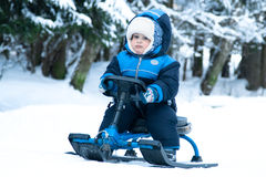 pojke little ridningsnowmobile Royaltyfri Fotografi