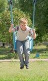 pojke little swing Arkivfoto