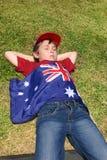 Pojke med den australiensiska flaggan Royaltyfria Foton