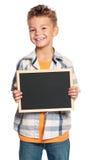 Pojke med den små blackboarden Royaltyfria Bilder