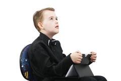 Pojke med en dator Royaltyfria Foton