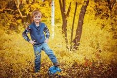 Pojke med en fotbollboll Royaltyfria Bilder