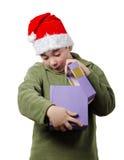Pojke med en gåva Arkivfoto